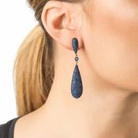 Design:  Designed as a brilliant-cut elongated drop, suspended from a similar-shape surmount. These earrings feature an array of sparkling zirconia set in 925 sterling silver which add a striking pop of colour.    The vast amount of zirconia make the...