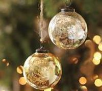 Very easy to recreate this look with looking glass Krylon spray and water bottle! Spray water on clear glass ornaments and the use Krylon or Rustoleum spray to create mercury effect!