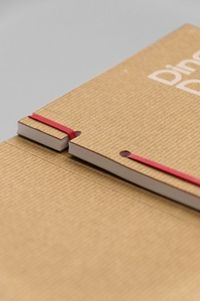 Rubber band binding Seasonal Flyer : http://magpie-studio.com/projects.php?projectid=169binding