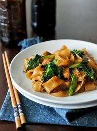 Pad See Ew. This is a different kind of noodles, which is fatter that the Thai's used from their normal noodles for pad Thai. You can make this using WORLDFOODS pad Thai noodle sauce but find the fatter rice noodles!:-) This is my favorite Thai fo...