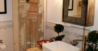 Modern Country bathroom with rustic charm..Love the old door and reclaimed table with sink.. great idea..