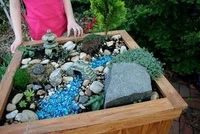 Backyard fairy garden. Maybe I need to pick up another planter for Maddie!