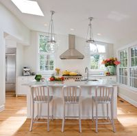 Remodeled kitchen with new island placed on axis with range and range hood