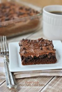Gooey frosted Chocolate Cake Bars: made with a mix, these bars are filled with cream cheese and cocoa!