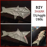 Ever since Theresa made Kira a mermaid tail, Logan has been asking me for a shark tail! Theresa and I have been trying to get together for months to create a pattern, but unfortunately life happene�€�