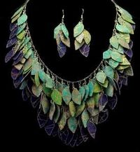 A beautiful hand painted necklace made of gold batik fabric and silver colored chain. Created in blues, turquoise, greens and purples with golden accents. 22 inch long chain with a toggle clasp (not shown). Each piece is made with my unique propri...
