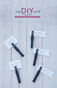CHALKBOARD CLOTHESPIN DIY ESCORT CARDS