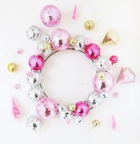 Told you I would be back with another Christmas disco ball DIY! This time it is an easy to make wreath. So much color and sparkle- love it!! Materials: Disco Ba