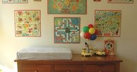 awesome! game boards as wall art! kids room, play room and why not a candyland board in the kitchen?