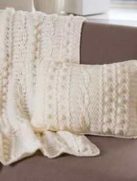 Free Pattern Popcorn and Twists Afghan and Pillow: Crocheted afghan and matching pillow embellished by popcorn and twist stitches. A great home décor project in Bravo Worsted or Northern Worsted by Schachenmayr original yarns.