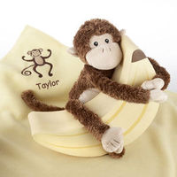 New moms will go bananas for Monkey Magoo when he swings into the nursery with his blankie, Too! Your plush new monkey friend wraps around a Keepsake Banana Box which, when opened, reveals a cuddly-cozy soft blanket.