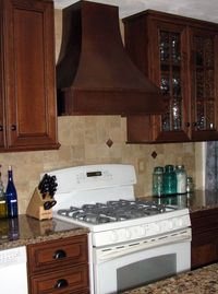 ColorCopper antique-copper-hood; Cambria quartz in Canterbury; Woodland Cherry Cabinetry in Winfield design, Sienna stain with Ebony glaze.