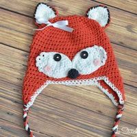 Make this Pretty Little Fox Hat for the bright-eyed and bushy-tailed baby girl in your life. Learn how to crochet a baby hat that resembles a cute, girly fox.