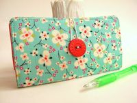 cherries, checkbook cover and wallets.