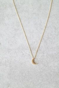 "In silver A sweet little crescent moon on a delicate gold chain. Details:  18""  Lobster clasp closure Gold plated Handcrafted For questions related to shipping, please visit our FAQ's page."