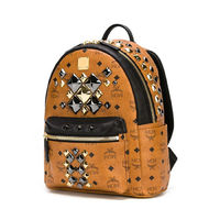 MCM Small Stark Brock Studded Backpack In Brown