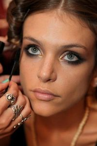 Backstage Beauty From MIA Swim Week: A smoky metallic eye was the perfect complement to Mara Hoffman's modern desert girl look -- the makeup was bohemian but not overly soft.