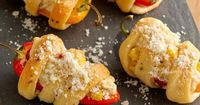 Creamy corn filled sweet peppers are an easy appetizer to whet the appetite before your big Thanksgiving meal. Petite sweet bell peppers are hollowed out and fi