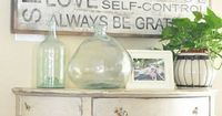 faded, distressed gray sign of 'words to live by', distressed white table and great bottles - casual beach style