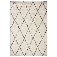 Wool shag rug with a lattice motif. Handmade in India. Product: RugConstruction Material: 100% Wool