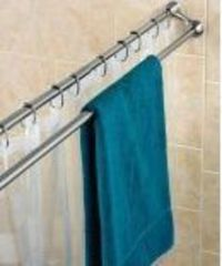 Summertime doesn't have to mean wet towels and swimsuits drip-drying all over your bathroom floor. Put up an extra shower curtain rod instead: