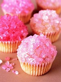 Frosted cupcakes with rock candy.