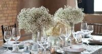 """Winter Wedding Centerpiece babys breath with curly willow branch """"chandelier"""" with baubles."""