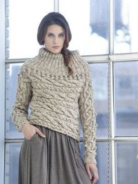 The cable pattern used to make this knit sweater really makes this a one-of-a-kind item.