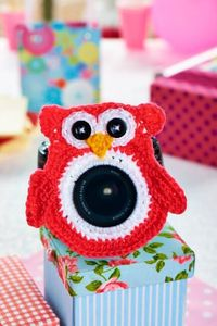 Our crochet camera lens buddy is great for keeping baby's attention. Find the pattern in issue 50, on sale 12/4