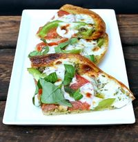 This pesto tortilla pizza is so much healthier than the calorie laden pizzas we know and love! It's super easy and SO delicious!