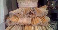 Dress made of vintage book pages and sheet music. Amazing. Kinda hard to sit down in, I think.