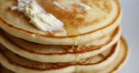 """Fluffy Pancakes   """"Tall and fluffy. These pancakes are just right. Topped with strawberries and whipped cream, they are impossible to resist."""""""