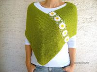 I like it very much! This is knitted and then add the crochet flowers.