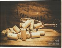 Corks & Tipples Wood Print | Wine glass with an assortment of bottle corks lying on a rustic wooden table and background with lettering conceptual of holiday, wedding or anniversary celebrations | #tipple #cellar #barart #homebar #wino #woodart #woode...