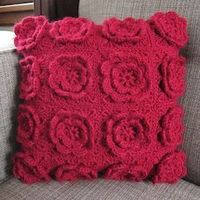 Turn 3D-flower granny squares into a fun textural throw pillow; from Just Crafty Enough blog