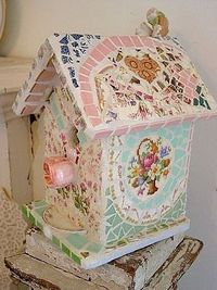 Birdhouse decorated with broken china.