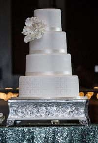 White Wedding Cake with silver accents. From