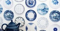 Trompe l'oeil wallpaper covered in blue porcelin plates, you have papered my heart with coveting. ($180)