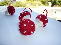 these little toadstools are a quick little Christmas ornament to make. Buy leaving off the hanging loop and filled with a little catnip they also make great cat toys.You only need a small amount of yarn so great for using up little bits.