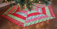 Holly Jolly ... by A Bright Corner | Quilting Pattern - Looking for your next project? You're going to love Holly Jolly Christmas Tree Skirt Pattern by designer A Bright Corner. - via