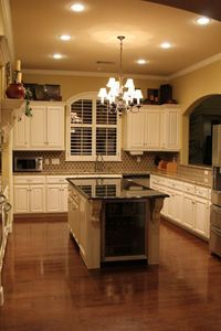 Kitchen - white cabinets. Not sold on white cabinets, maybe cream... But I love the look of this kitchen!