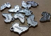 Pack of 20 Silver Coloured Africa Map Shape Charms 21mm x 14mm Ethnic Jewellery Pendants. £8.99