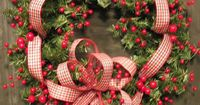 berry & ribbon Christmas wreath | at first I thought this was too busy, but it's growing on me... #country