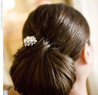 Amanda wore her hair in a lovely, low chignon. Her look was embellished with a crystal hair jewel, a suggestion from her stylist that worked perfectly. �€œI heard from all the women in the congregation that it sparkled and shined on the altar w...