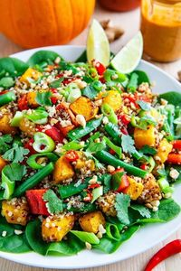 A quinoa salad with roasted pumpkin, green beans and red peppers in a Thai style peanut sauce dressing.