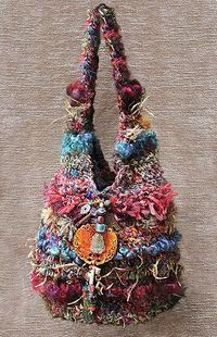 Bird's Nest Crochet Roving Bags. Funky bags made from fun fibers: recycled sari silk, banana silk, bamboo, twine, wool roving and novelty fibers. Can't find pattern, but would probably be easy to make.