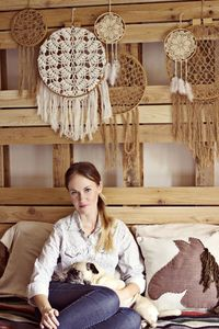 Love the crochet / doily dreamcatchers on this big wooden bedframe!!