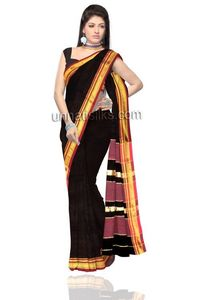 this lovely rustic black color pure handloom Mangalgiri cotton saree. The saree is beautified with self color woven decorative motifs all over and zari woven pale maroon ethnic patterns over the pallu heightened the look. The zari woven border along wit...