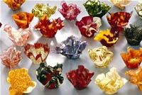 Professional artists and crafters, like Margaret Dorfman, have gained notoriety creating fruit and vegetable parchment bowls. These delicate looking bowls can b