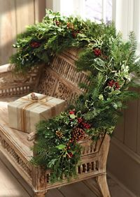 christmas garlands, christmas decorations and porch chairs.